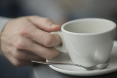 Young man holding cup of coffee  inside the coffee shop Royalty Free Stock Photo