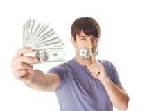 Young man holding a dollar bills  his mouth sealed Stock Photos
