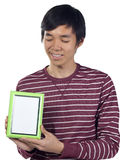 Young man holding an empty picture frame Royalty Free Stock Photo