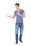 Young man holding empty plate Royalty Free Stock Images