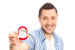Young man holding an engagement ring Stock Image