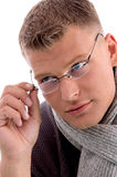 Young man holding eyewear stock image