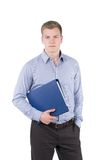 Young man is holding a file under his arm Royalty Free Stock Image