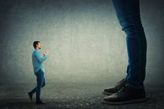 Fight against boss. Young man holding fists ready to fight his big boss. Office confrontation Stock Images