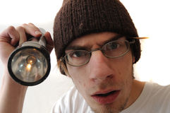 Young Man Holding Flash Light Stock Photo