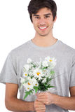 Young man holding flower bouquet Royalty Free Stock Photos
