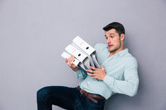 Young man holding folders Stock Images