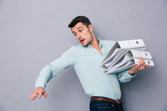 Young man holding folders Royalty Free Stock Photography