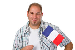 Young man holding french flag Royalty Free Stock Photo