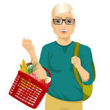 Young man holding a full shopping basket Royalty Free Stock Images