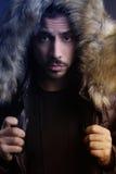 Young man holding a fur hood Royalty Free Stock Photos