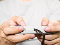 A young man holding game controller playing video games Royalty Free Stock Photography