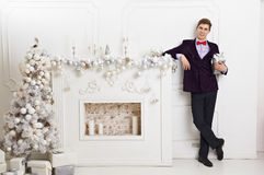 Young man holding gift box. With xmas decorations Stock Photography