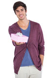 Young man holding a gift Royalty Free Stock Photos