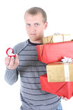 Young man holding gifts Stock Image