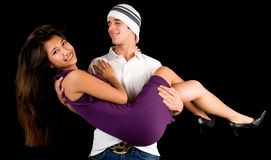 Young Man Holding Girl in his Arms Stock Photography