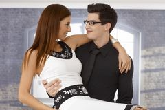 Young man holding girlfriend in arms Royalty Free Stock Images