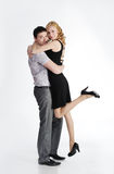 Young man holding girlfriend in his arms Royalty Free Stock Photos