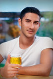 Young Man Holding a Glass in a Bar Stock Image