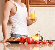 Young Man Holding Glass of Orange Juice Royalty Free Stock Image