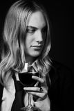 Young  man holding glass of red vine Royalty Free Stock Photography