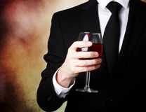 Young man holding a glass of red wine Royalty Free Stock Photo