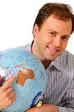 Young man holding a globe. Pointing at Australia, isolated on white background Royalty Free Stock Images