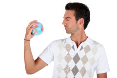 Young man holding a globe Royalty Free Stock Photo