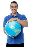 Young man holding globe map Stock Photos