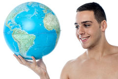 Young man holding globe map Stock Photo