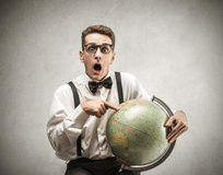 Young man holding a globe Stock Photos