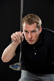 Young man holding a golf club Stock Photography