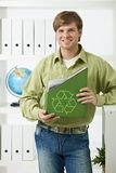 Young man holding green folder Royalty Free Stock Photo