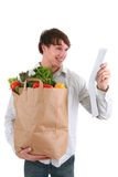 Young Man Holding Groceries Paper Bag and Receipt Royalty Free Stock Photos