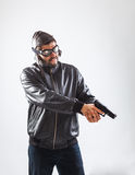 Young man holding a gun with both hands Royalty Free Stock Photography