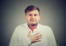 Man feeling guilty and embarrassed royalty free stock photo