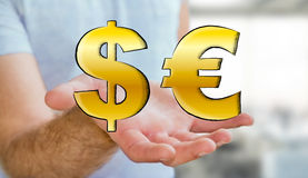 Young man holding hand drawn dollar and euro icons Royalty Free Stock Images
