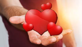 Young man holding hand drawn red heart Stock Photo