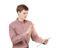 Young man holding hand in front of tablet and browsing sites Stock Image