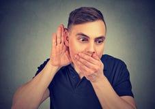 Shocked man listening to rumors royalty free stock image