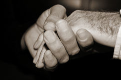 Young man holding the hand of an old man, in black and white Royalty Free Stock Photos