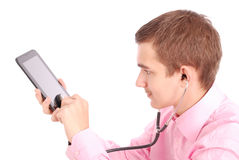 Young man holding hands tablet PC and listening to music Stock Images