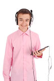 Young man holding hands tablet PC and listening to music Royalty Free Stock Photography
