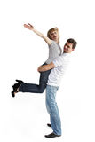 Young man holding a happy girl Royalty Free Stock Photos