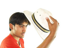Young man holding hat Stock Photography