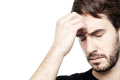 Young man holding head in hand stock images