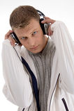 Young man holding the headphone Stock Photos
