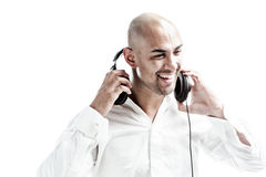 Young man holding headphones smiling Stock Photo