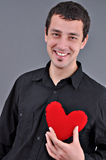 Young Man Holding Heart Stock Photography