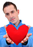 Young Man Holding Heart Royalty Free Stock Images